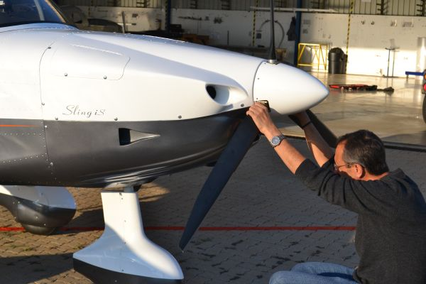 Mike Blyth does a mandatory inspection of a newly built plane before taking it on a test flight. According to Blyth, such meticulous inspections and quality control measures have made the Sling one of the most reliable light sport aircraft in the world. (Image: Shamin Chibba)